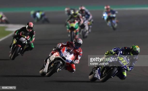 Movistar Yamaha MotoGP's Italian rider Valentino Rossi and Italian Andrea Dovizioso of the Ducati Team compete during the 2017 Qatar MotoGP at the...
