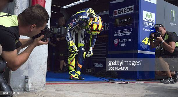 Movistar Yamaha MotoGP's Italian rider Valentino Rossi bows prior to the qualification of the Moto GP Czech Grand Prix in Brno Czech Republic on...