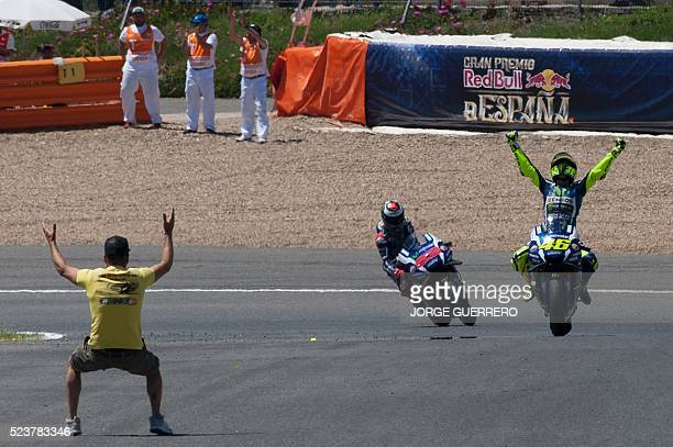 Movistar Yamaha MotoGP's Italian rider Valentino Rossi celebrates his victory at the end of the MotoGP race of the Spanish Moto Grand Prix at the...