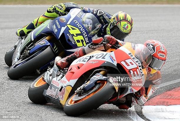 Movistar Yamaha MotoGP's Italian rider Valentino Rossi chases Repsol Honda Team's Spanish rider Marc Marquez during the 2015 MotoGP Malaysian Grand...