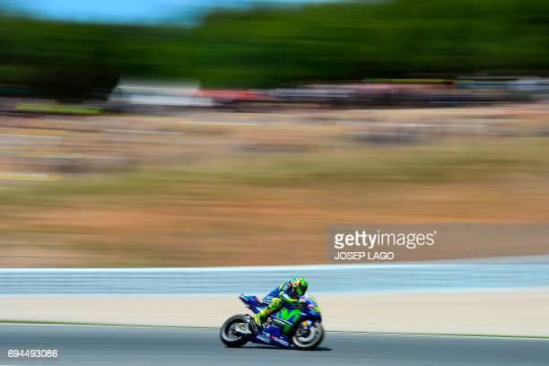 TOPSHOT Movistar Yamaha MotoGP's Italian rider Valentino Rossi competes during the MotoGP qualifying session of the Moto Grand Prix de Catalunya at...