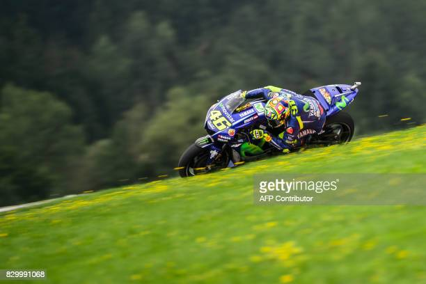 TOPSHOT Movistar Yamaha MotoGP's Italian rider Valentino Rossi competes during the first practice session of the MotoGP Austrian Grand Prix weekend...