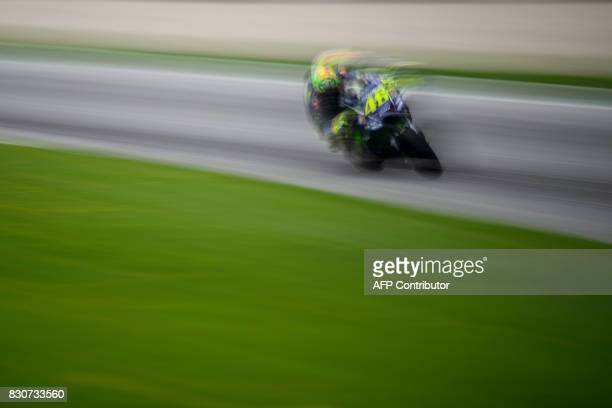 TOPSHOT Movistar Yamaha MotoGP's Italian rider Valentino Rossi competes during the fourth practice session of the MotoGP Austrian Grand Prix weekend...