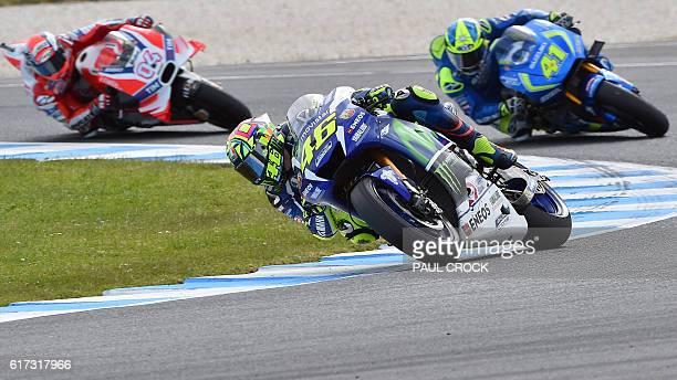 Movistar Yamaha MotoGP's Italian rider Valentino Rossi powers ahead Team Suzuki Ecstar Spanish rider Maverick Vinales and Ducati Team's Italian rider...