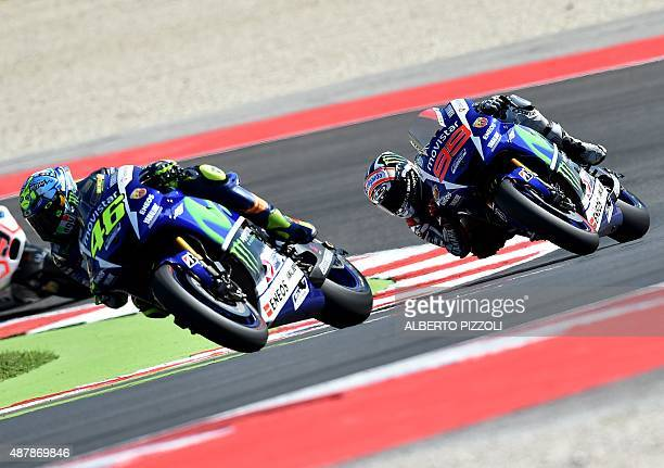 Movistar Yamaha MotoGP's Italian rider Valentino Rossi rides ahead of Movistar Yamaha MotoGP's Spanish rider Jorge Lorenzo during the qualifying...