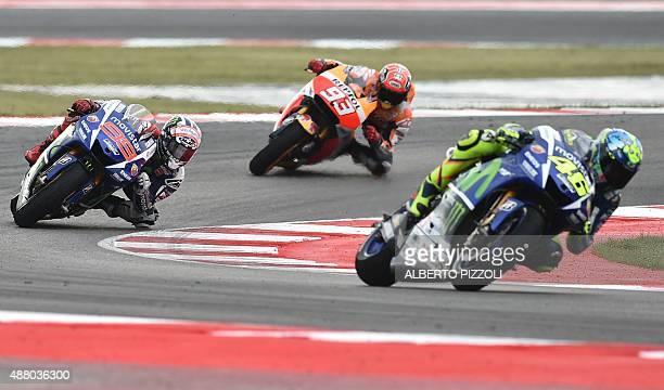 Movistar Yamaha MotoGP's Italian rider Valentino Rossi rides ahead of Movistar Yamaha MotoGP's Spanish rider Jorge Lorenzo and Repsol Honda Team's...