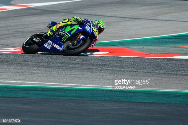 TOPSHOT Movistar Yamaha MotoGP's Italian rider Valentino Rossi takes a chicane during the third MotoGP free practice session of the Moto Grand Prix...