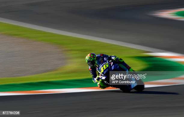 TOPSHOT Movistar Yamaha MotoGP's Italian rider Valentino Rossi takes a curve during the third MotoGP free practice session of the Valencia Grand Prix...