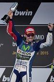 Movistar Yamaha MotoGP's Spanish rider Jorge Lorenzo celebrates on the podium after winning the MotoGP race of the Spanish Grand Prix at the Jerez...