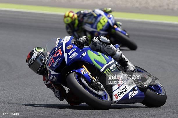 Movistar Yamaha MotoGP's Spanish rider Jorge Lorenzo competes ahead of Movistar Yamaha MotoGP's Italian rider Valentino Rossi during the Catalunya...