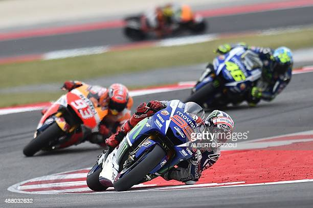 Movistar Yamaha MotoGP's Spanish rider Jorge Lorenzo rides ahead of Repsol Honda Team's Spanish rider Marc Marquez and Movistar Yamaha MotoGP's...
