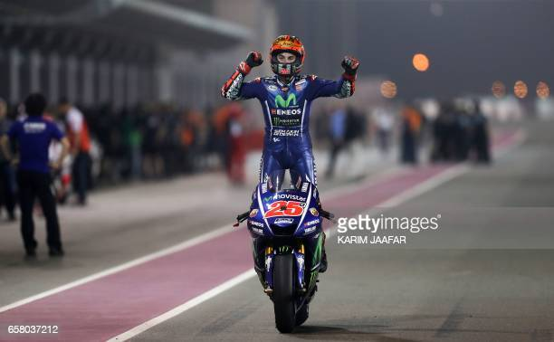 TOPSHOT Movistar Yamaha MotoGP's Spanish rider Maverick Vinales celebrates after winning the 2017 Qatar MotoGP at the Losail International Circuit...