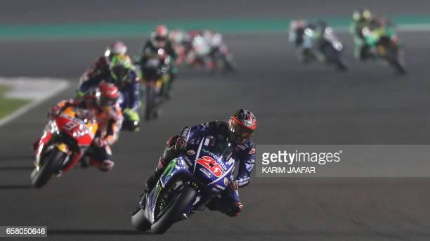 TOPSHOT Movistar Yamaha MotoGP's Spanish rider Maverick Vinales competes during the 2017 Qatar MotoGP at the Losail International Circuit north of...