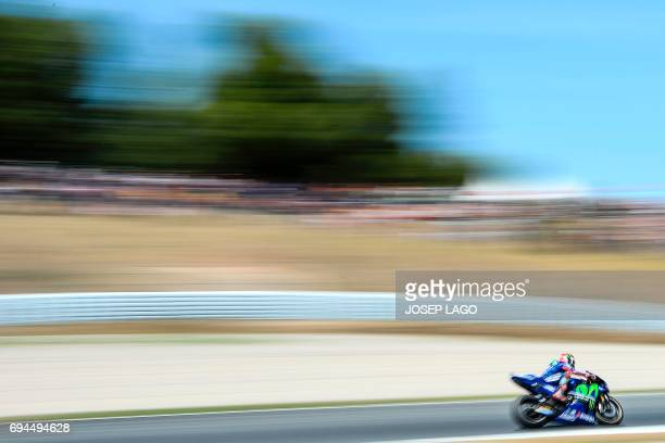 CORRECTION Movistar Yamaha MotoGP's Spanish rider Maverick Vinales competes during the MotoGP qualifying session of the Moto Grand Prix de Catalunya...