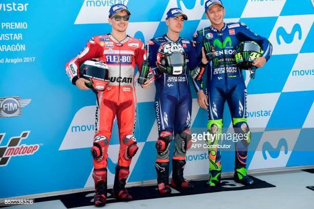 Movistar Yamaha MotoGP's Spanish rider Maverick Vinales Ducati Team's Spanish rider Jorge Lorenzo and Movistar Yamaha MotoGP's Italian rider...