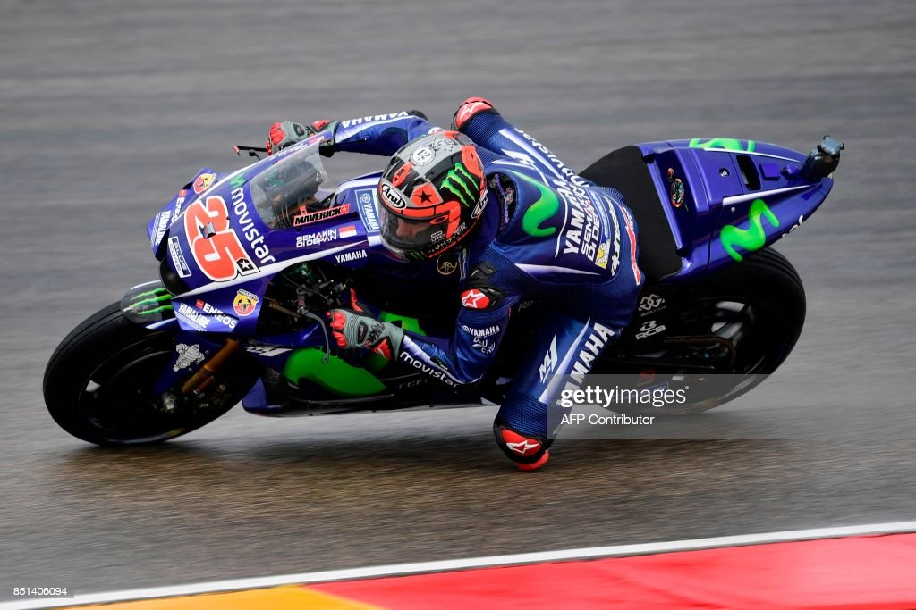 Movistar Yamaha MotoGP's Spanish rider Maverick Vinales rides during the Moto GP second free pratice of the Moto Grand Prix of Aragon at the Motorland circuit in Alcaniz on September 22, 2017. /