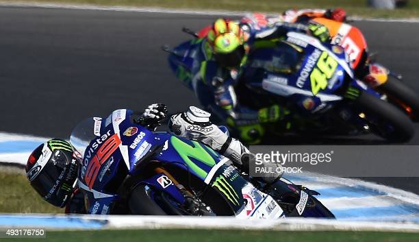 Movistar Yamaha rider Jorge Lorenzo leads teammate Valentino Rossi of Italy and Repsol Honder rider Marc Marquez of Spain during the early stages of...