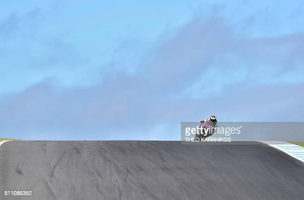 Movistar Yamaha's Spanish rider Jorge Lorenzo comes out of turn 9 during the second day of 2016 preseason test on Phillip Island on February 18 2016...