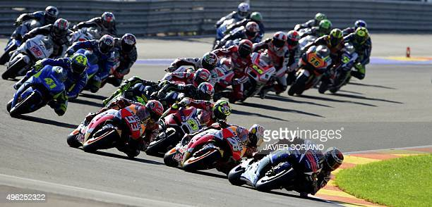 Movistar Yamaha's Spanish rider Jorge Lorenzo leads after the start of the MotoGP motorcycling race at the Valencia Grand Prix at Ricardo Tormo...