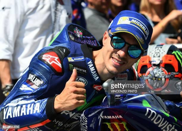 Movistar Yamaha's Spanish rider Maverick Vinales celebrates his pole position at the end of the Moto GP qualifying session of the Italian Grand Prix...