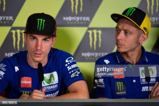 Movistar Yamaha's Spanish rider Maverick Vinales speaks beside Movistar Yamaha's Italian rider Valentino Rossi during a press conference at the...