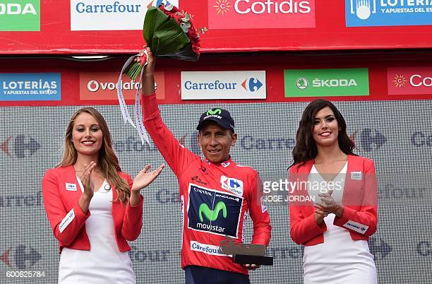 Movistar's Colombian cyclist Nairo Quintana celebrates his Red Jersey on the podium of the 18th stage of the 71st edition of 'La Vuelta' Tour of...