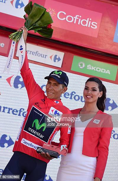 Movistar's Colombian cyclist Nairo Quintana celebrates on the podium retaining the red jersey after the 19th stage of the 71st edition of 'La Vuelta'...