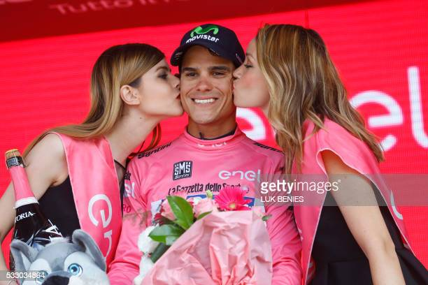 TOPSHOT Movistar's Costa Rican rider Andrey Amador celebrates the pink jersey of the overall leader on the podium of the 13th stage of the 99th Giro...