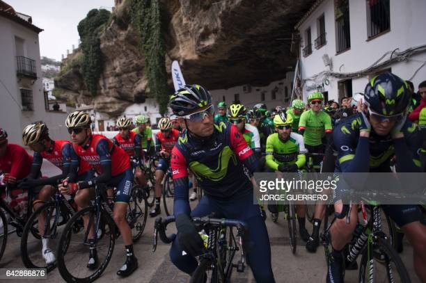 Movistar's Spanish cyclist Alejandro Valverde C waits with riders for the start of the last stage of the 'Ruta del Sol' tour a 1515 km ride from...