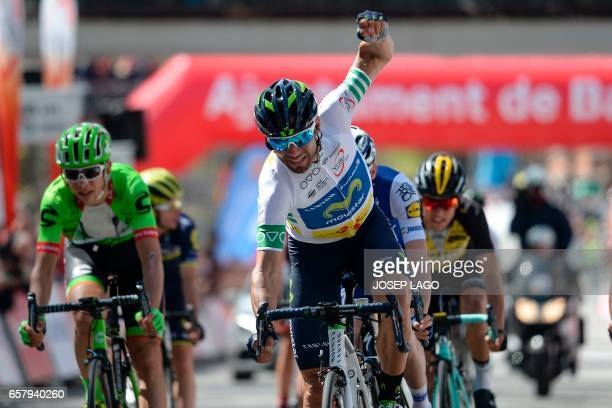 Movistar's Spanish rider Alejandro Valverde celebrates as he crosses first the finish line on the seventh and last day of the 97th Volta Catalunya...