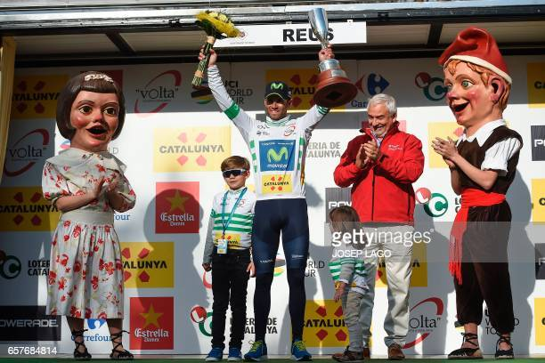 Movistar's Spanish rider Alejandro Valverde celebrates his overall leader jersey on the podium on the sixth day of the 97th Volta Catalunya 2017 a...