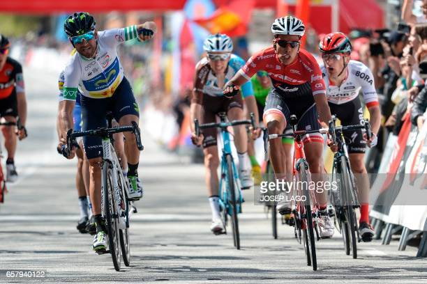 Movistar's Spanish rider Alejandro Valverde crosses first the finish line followed by Trek's Colombian rider Jarlinson Pantano on the seventh and...