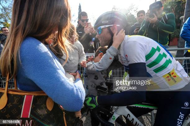 Movistar's Spanish rider Alejandro Valverde is congratulated by his family after the sixth day of the 97th Volta Catalunya 2017 a 1897km stage from...
