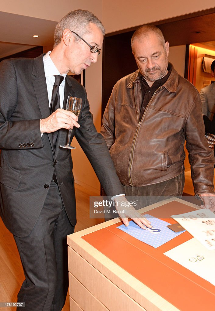 Moynat President Guillaume Davin (L) speaks with <a gi-track='captionPersonalityLinkClicked' href=/galleries/search?phrase=Jean-Pierre+Jeunet&family=editorial&specificpeople=212947 ng-click='$event.stopPropagation()'>Jean-Pierre Jeunet</a> attend the Moynat London boutique opening on March 12, 2014 in London, England.