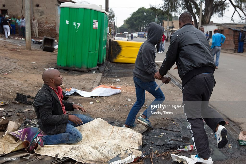 Mozambican national Emmanuel Sithole is attacked by men in Alexandra Township on April 18 2015 in Alexandra South Africa Sithole was stabbed in the...