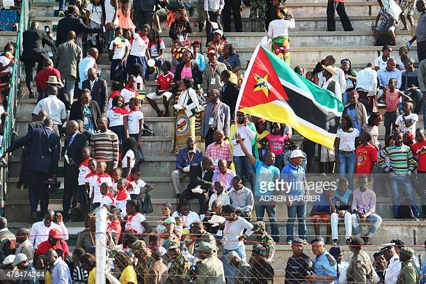 Mozambican people celebrate some waving Mozambican national flags during the celebrations for the 40th anniversary of Mozambican independence from...