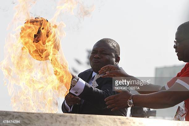 Mozambican President Filipe Nyusi lights up a flame during the celebrations for the 40th anniversary of Mozambican independence from Portugal at the...