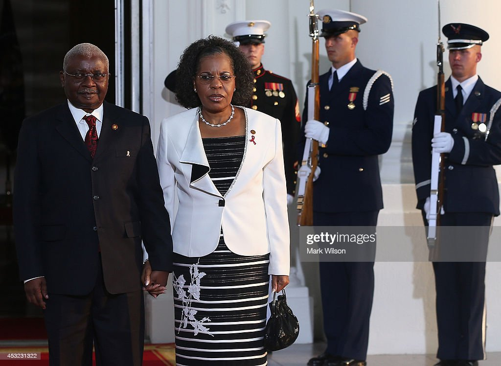 Mozambique President Armando Emilio Guebuza and spouse Maria da Luz Dai Guebuza arrive at the North Portico of the White House for a State Dinner on the occasion of the U.S. Africa Leaders Summit, August 5, 2014 in Washington, DC. African leaders are attending a three-day-long summit in Washington to strengthen ties between the United States and African nations.