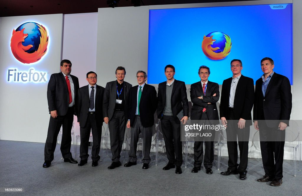 Mozilla's CEO Gary Kovacs (R) poses with his partners for the launch this summer of new smartphones with its new open-source Firefox OS mobile operating system, (L-R) America Movil's Chief Marketing Officer (CMO) Marco Quatorze, ZTE's Executive Vice President (EVP) and Head of the Terminal Division He Shiyou, Telenor's Chief Executive Officer (CEO) Jon Fredrik Baksaas, Telefonica's Chairman and CEO Cesar Alierta, Deutsche Telekom's Chairman and CEO Rene Obermann, Telecom Italia's CEO and GSMA's chairman Franco Bernabe and Qualcomm's CEO Paul Jacobs after a press conference in Barcelona on February 24, 2013, a day before the start of the 2013 Mobile World Congress. The 2013 Mobile World Congress, the world's biggest mobile fair, is held from February 25 to February 28 in Barcelona.
