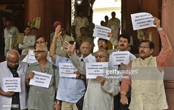 MPs and Aam Aadmi Party MP Dharamvira Gandhi staging a demonstration demanding renaming of Chandigarh Airport as Martyr Bhagat Singh name on his...