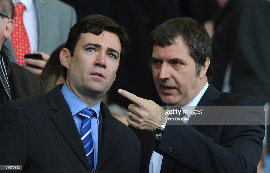 MPs Andy Burnham and Steve Rotherham look on prior to the Barclays Premier League match between Everton and Liverpool at Goodison Park on October 28...
