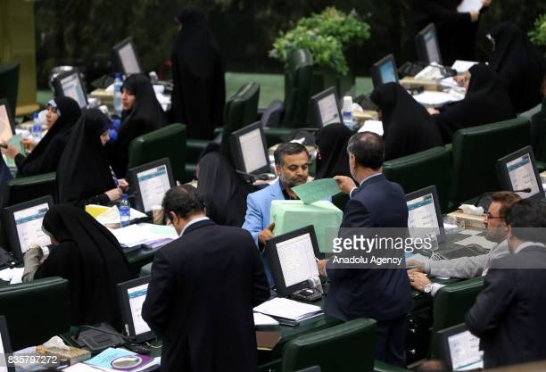 MPs cast their votes during a vote of confidence session on the President Hassan Rouhani's cabinet in Tehran on August 20 2017