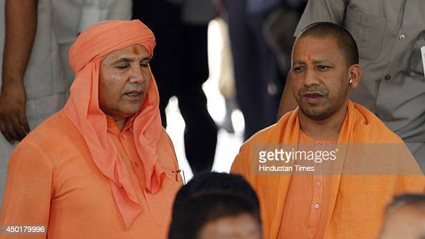 MPs Chand Nath along with Yogi Adityanath at Parliament house after attending Parliament session on June 6 2014 in New Delhi India Eighttime...