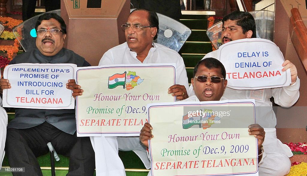 MPs from Andhra Pradesh sitting on dharna at main gate of Parliament demanding separate Telangana state during the opening day of Budget session on February 21, 2013 in New Delhi, India.
