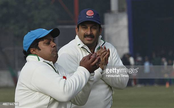 MPs Manoj Tiwari and Dushayant Singh during T20 match played between members of Parliament and journalists to support childrens health at DPS Mathura...