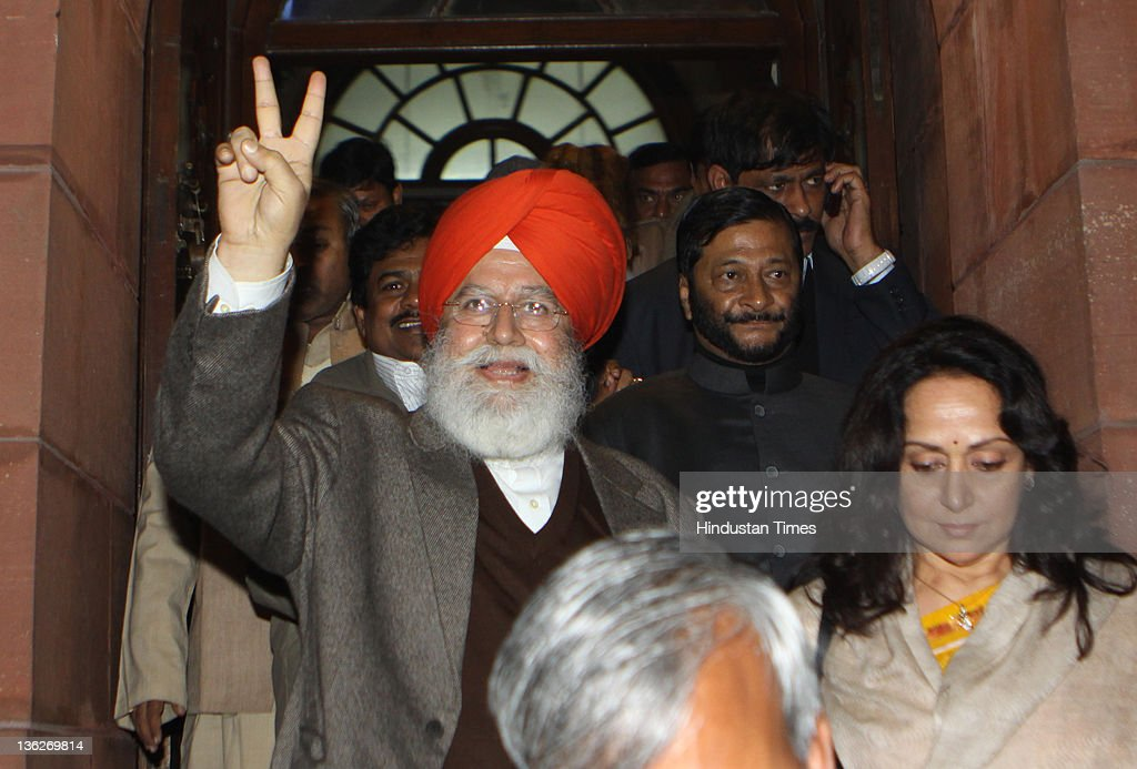 BJP MPs SS Ahluwalia, <a gi-track='captionPersonalityLinkClicked' href=/galleries/search?phrase=Hema+Malini&family=editorial&specificpeople=1026787 ng-click='$event.stopPropagation()'>Hema Malini</a> and Vinay Katiyar leave after discussion on Lokpal Bill in Rajya Sabha at Parliament on December 30, 2011 in New Delhi, India. The Rajya Sabha was adjourned sine die late on December 29, 2011 after a night of drama in the Upper House which ended without vote on the Lokpal Bill. The legislation to appoint an anticorruption watchdog was deferred at least till the next parliamentary session, amid criticism of the decision from an angry opposition.