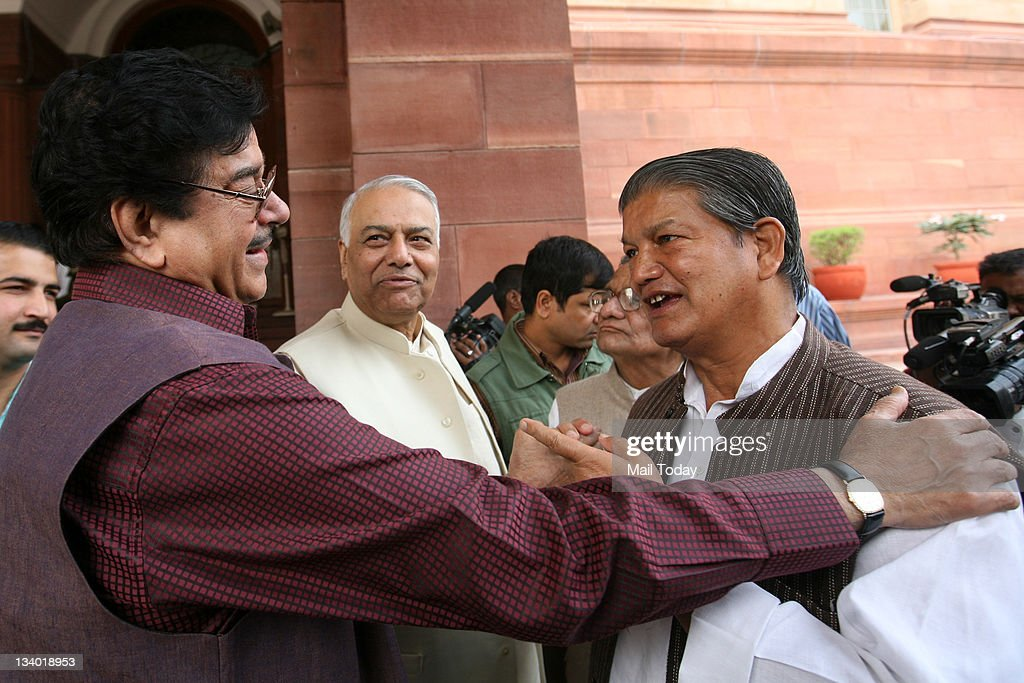 BJP MPs Yashwant Sinha, Shatrughan Sinha and Congress leader Harish Rawat during the winter session of Parliament in New Delhi on Wednesday.