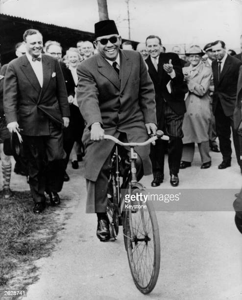 Mr Achmed Sukarno President of Indonesia riding a bicycle during an official visit to Copenhagen