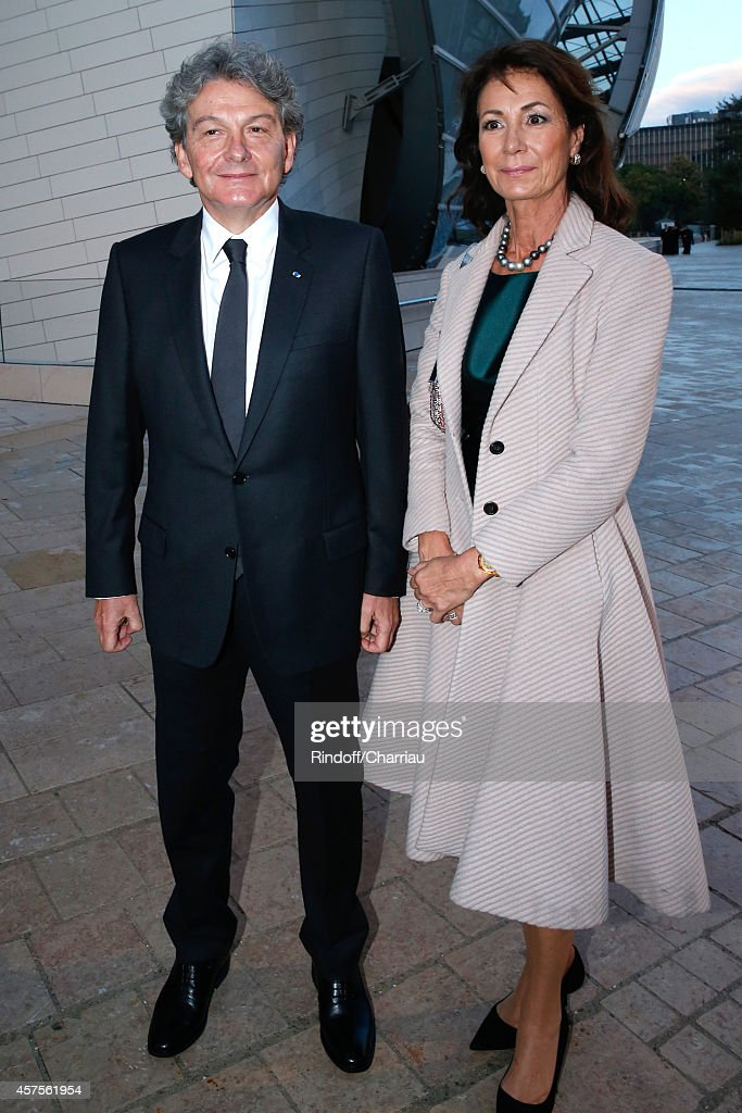 Mr and Miss Thierry Breton attend the Foundation Louis Vuitton Opening at Foundation Louis Vuitton on October 20, 2014 in Boulogne-Billancourt, France.