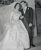 Mr and Mrs Conrad Nicholson Hilton Jr stand on the steps of the Church of the Good Shepherd after their wedding Bride is Elizabeth Taylor of the...